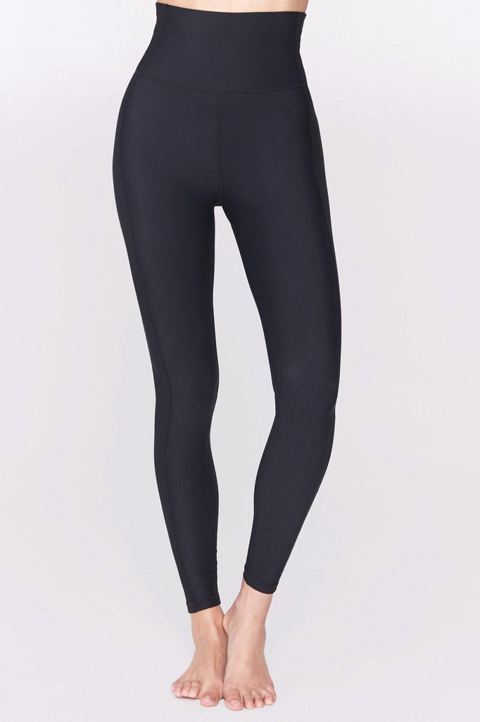 UNIKONCEPT Lifestyle boutique: image shows the Active High Waist Tight by Spiritual Gangster. There black, high waisted, full length leggings feature a seam both up the front and along the bum providing a super comfortable flattering fit. The spiritual gangster sits in the middle of your back along the waist band. A double seam detail runs down the side length of the leggings elongating and defining your legs perfectly.