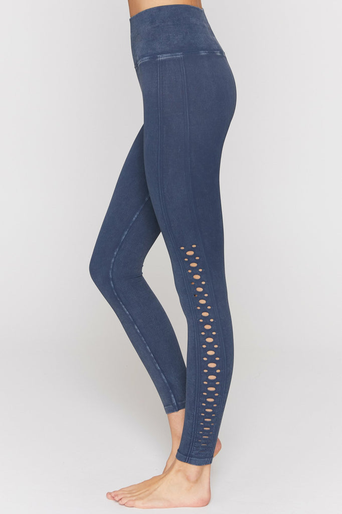 UNIKONCEPT: Lifestyle boutique; Image shows a pair of seamless navy blue leggings by spiritual gangster. The self love leggings feature ribbed detailing throughout to create high compression and small cut out eyelets at the side of the outer calf to knee.