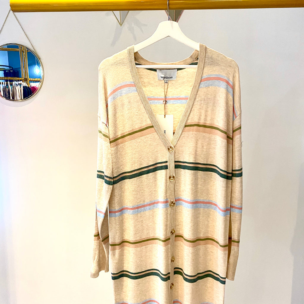 UNIKONCEPT: Lifestyle boutique; image shows a long duster like cardigan by Heartloom. The Dahlia cardigan features vertical buttons down the centre and horizontal stripes throughout. It is a nude/beige base colour with blue, green and pink stripes.
