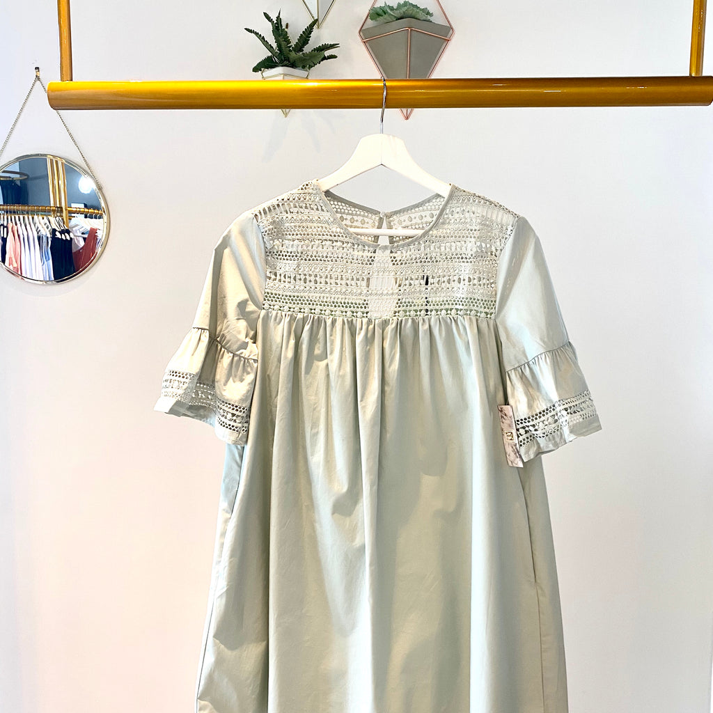 UNIKONCEPT Lifestyle boutique: Image shows the Minted Babydoll Dress by English Factory. This babydoll dress features a crocheted chest and sleeve detail. With a loose bodice and pockets the dress length falls mid thigh. There is a single button closure at the top of the back with a slight opening beneath. The dress comes in a delicate mint colour.