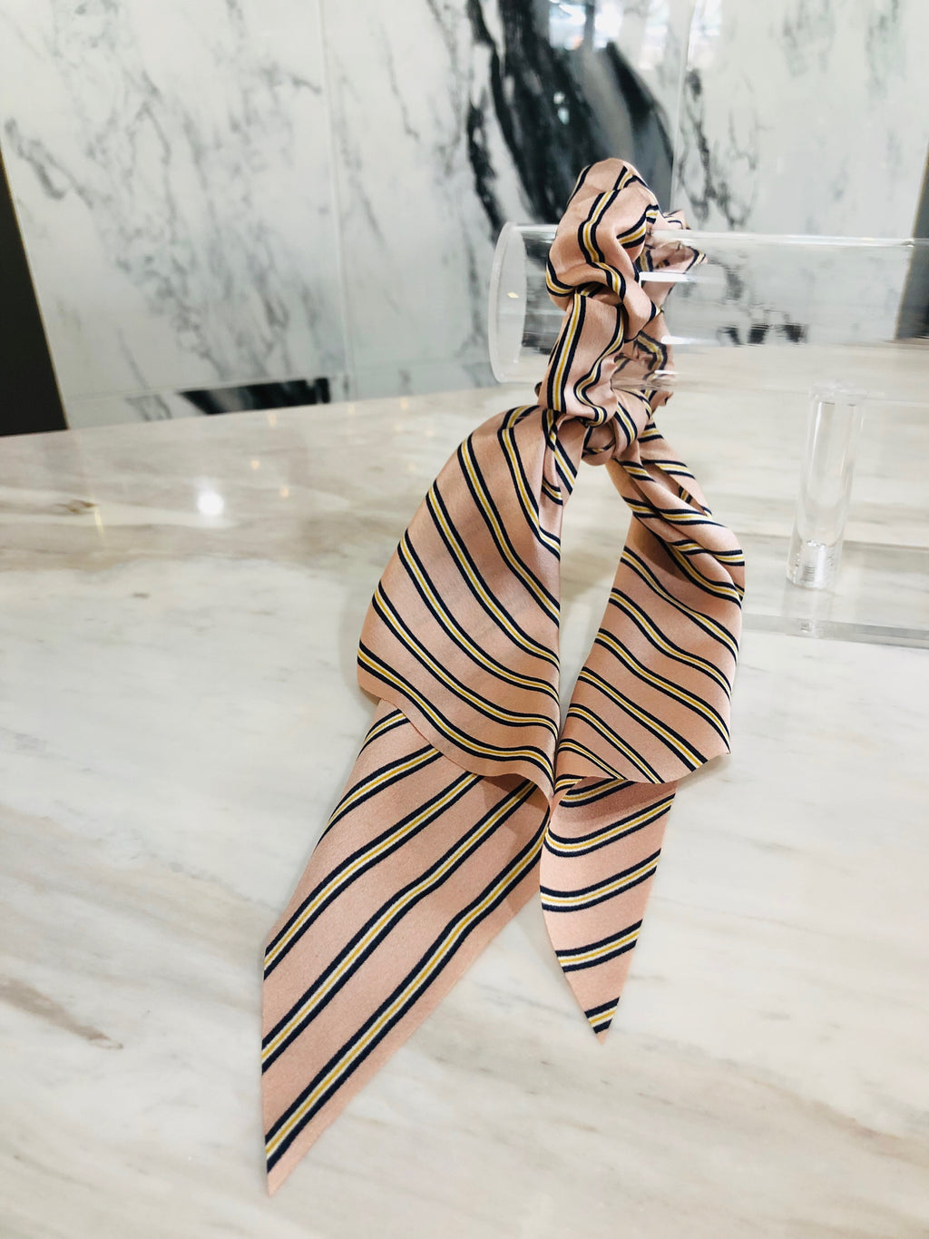 UNIKONCEPT Lifestyle boutique: Hair ribbons with elastic band to secure. This silk-like hair ribbon is baby pink with small navy blue and white striped pattern all over.