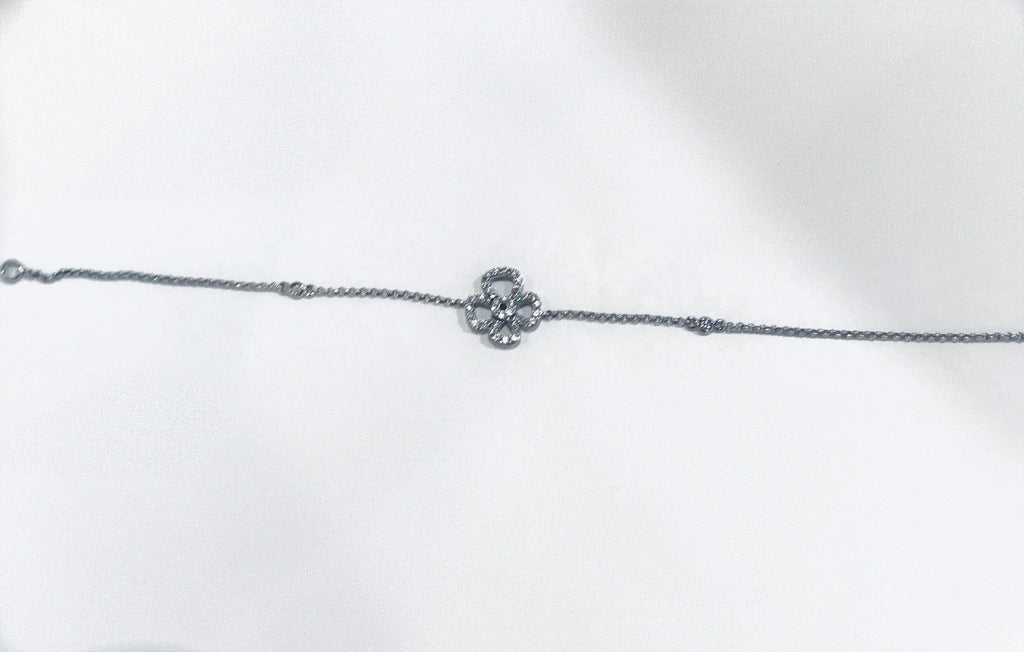 UNIKONCEPT Lifestyle boutique: Image shows the Clover Bracelet by Adamar. This dainty bracelet features a clover charm. Both the chain and clover are made of silver set throughout with swarovski crystals.