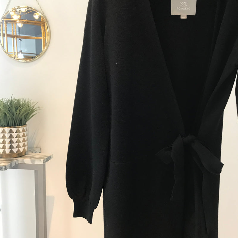 UNIKONCEPT Lifestyle boutique: Image shows a black knit Soia & Kyo long sleeve coatigan. The Carine coatigan is a wrap style coatigan with puffy sleeves and a mid length