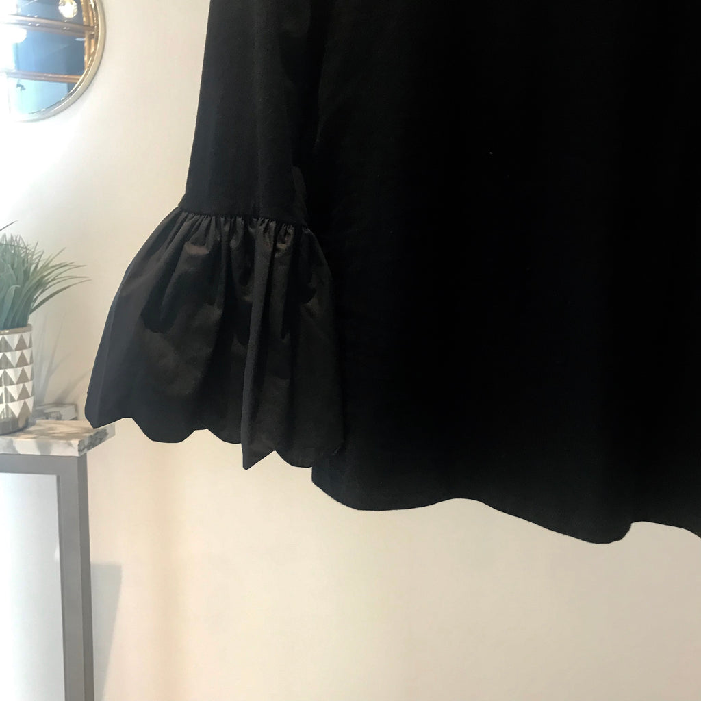 UNIKONCEPT Lifestyle boutique: Image shows a black 3/4 long sleeve by English Factory. The Angelina Poplin top is a scoop neck Long sleeve with large bell sleeves. The top is cropped and will fit perfectly over a pair of denim