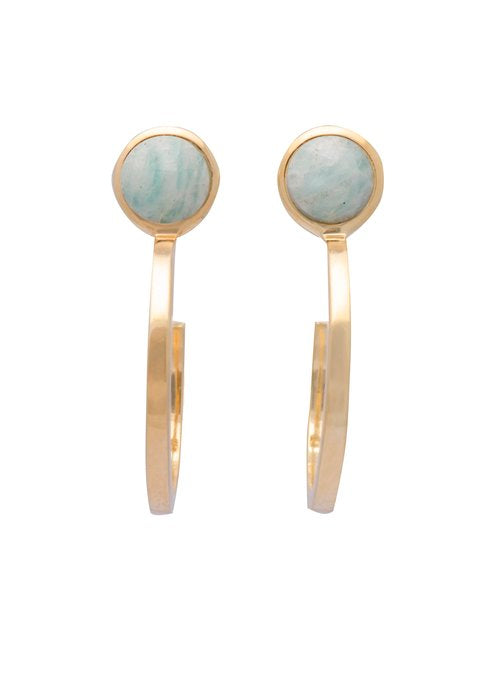 Image shows a pair of Sarah Mulder gold hoops. The ignite earrings in gold have a semi precious gemstone at the top, front facing of the earring, it is not a full circle it is about 3/4 of a hoop.