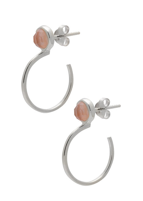Image shows a pair of Sarah Mulder gold hoops. The ignite earrings in silver have a semi precious gemstone at the top, front facing of the earring, it is not a full circle it is about 3/4 of a hoop.