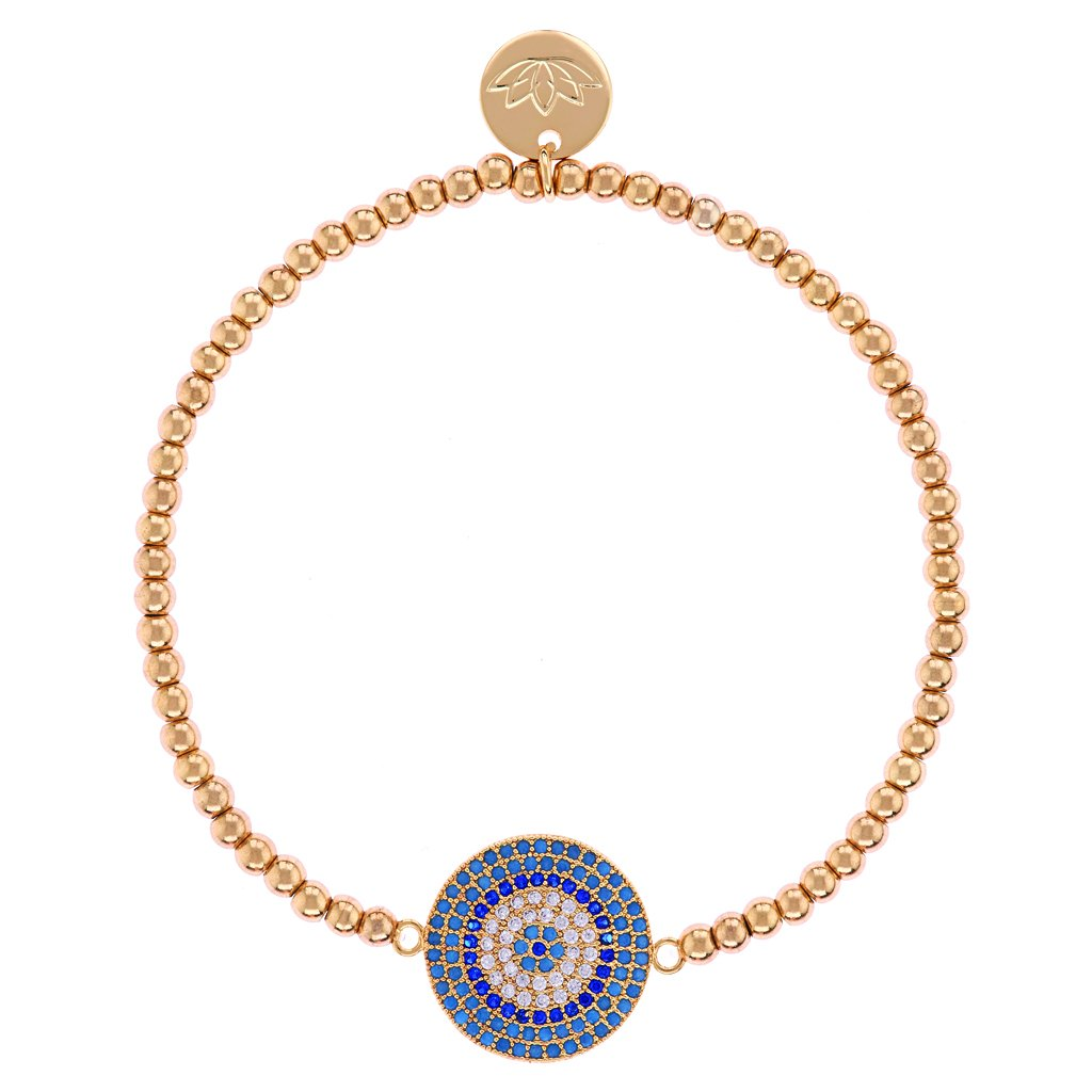 UNIKONCEPT lifestyle boutique: Image shows a tin gold beaded bracelet. The Luv & Bart Ariana bracelet is a gold beaded bracelet with a large circular blue pendant with multiple small blue crystals inside, the bracelet also features the luv and bart's signature logo, a lotus flower