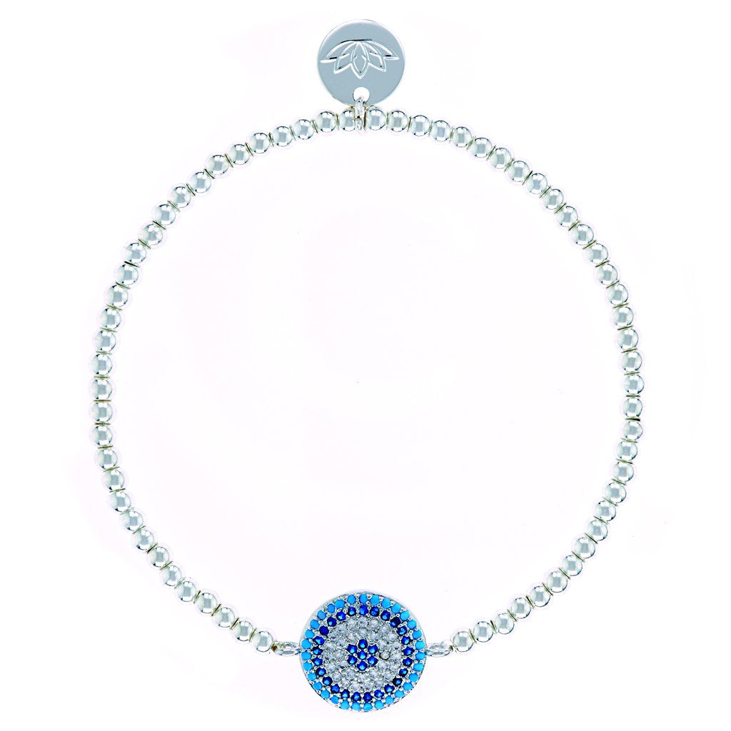 UNIKONCEPT lifestyle boutique: Image shows a thin silver beaded bracelet. The Luv & Bart Amani bracelet is an elastic beaded bracelet with a large circle blue pendant similar to that of an evil eye in the middle of it.