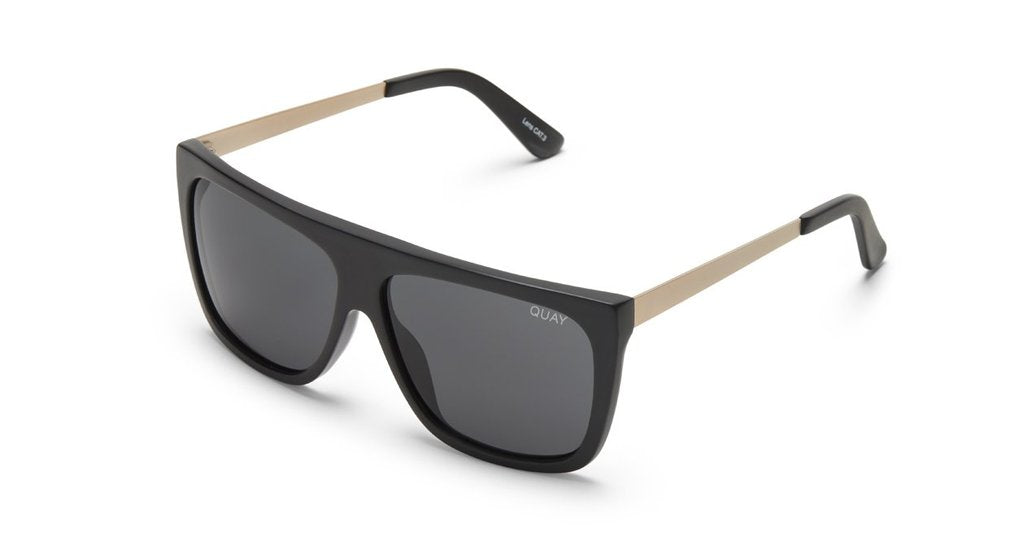 UNIKONCEPT:Lifestyle boutique; image shows a pair of oversize quay sunglasses. The OTL II are a large, oversized square frame that is completely blacked out.