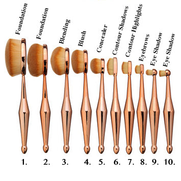 Image shows a variety of multipurpose makeup brushes with rose gold bases and thick oval bristle heads
