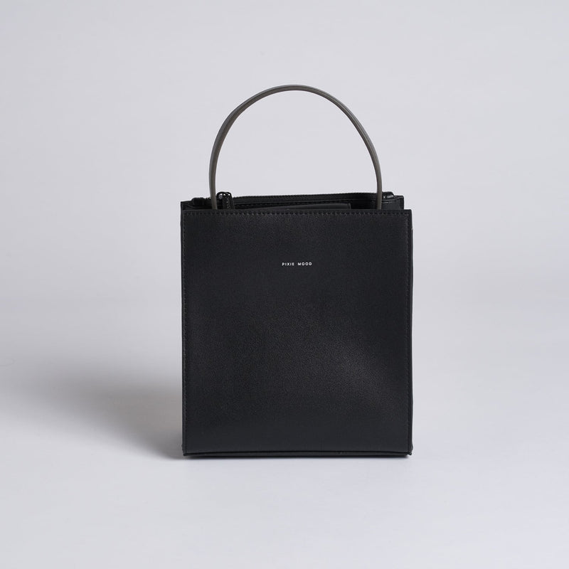 Black, faux leather, pixie mood handbag. The Daphne bag in black features a removable cross body strap and magnetic closure at the top of the bag.