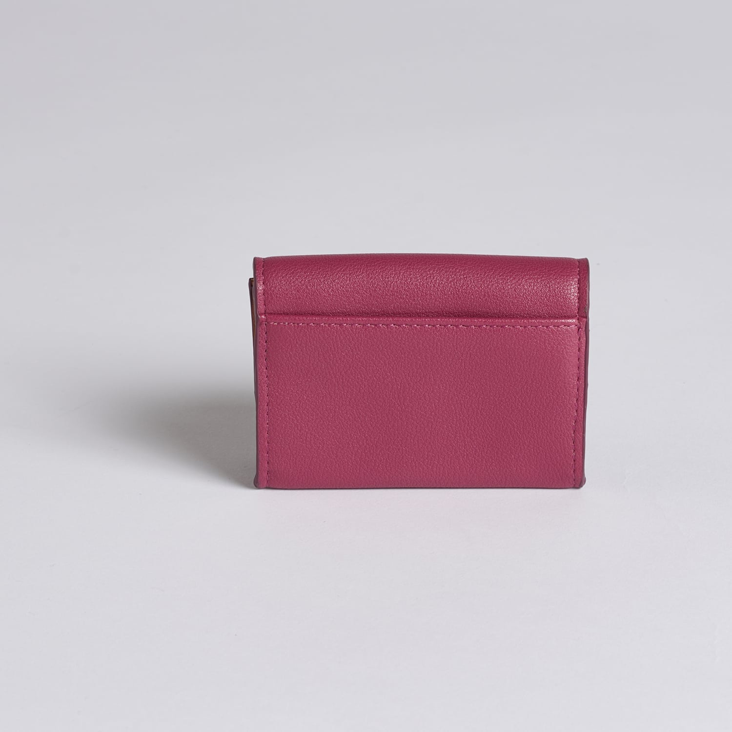 Fold over, envelope pixie mood credit card case. The carol case is magenta in colour