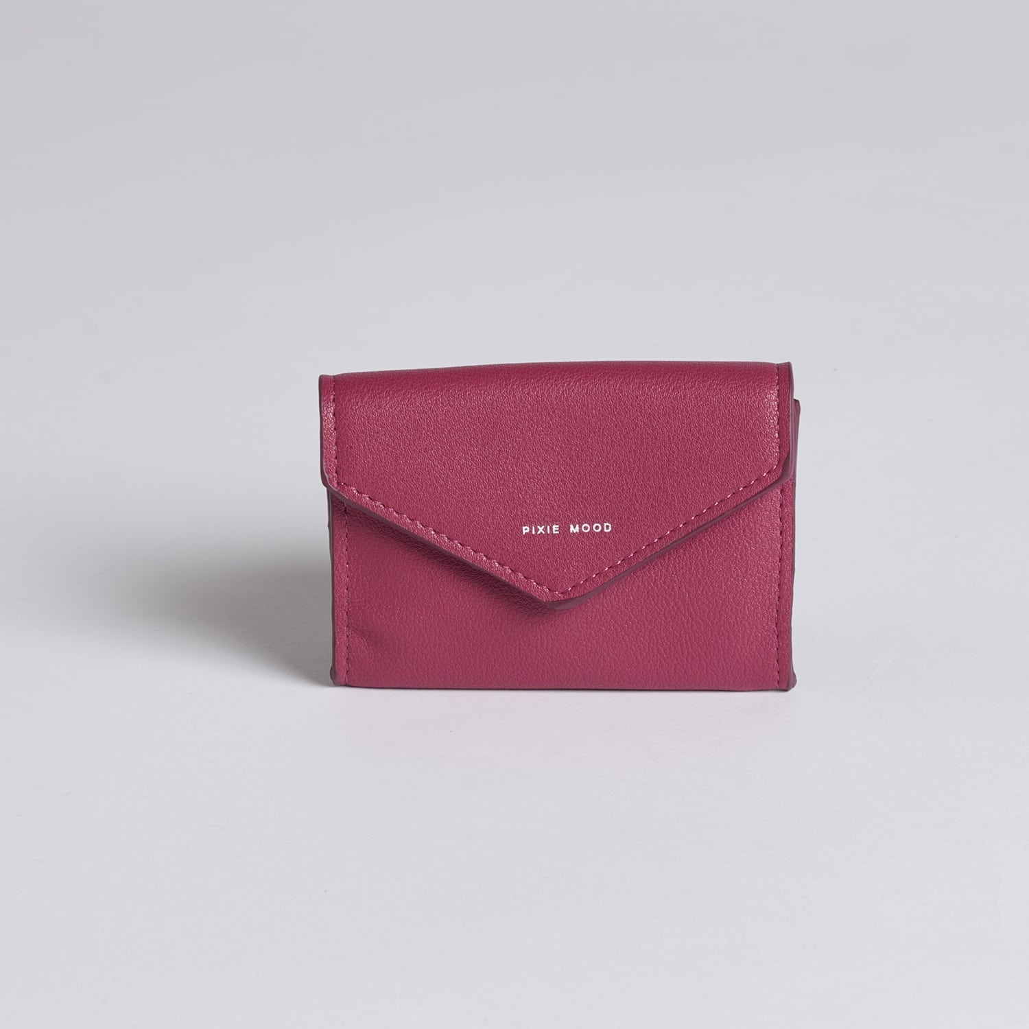 Fold over, envelope credit card case and magenta pink coloured.