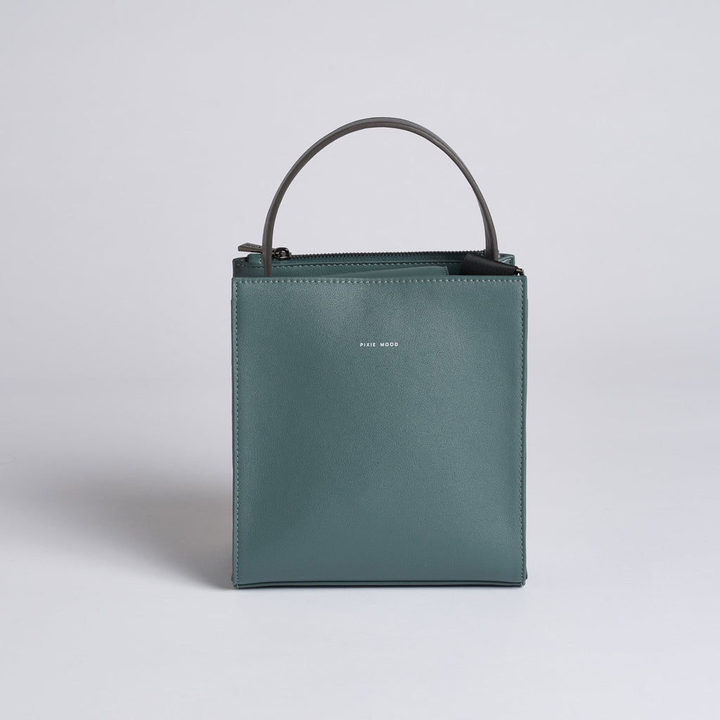 Spruce green, faux leather, pixie mood handbag. The Daphne bag in spruce green features a removable cross body strap and magnetic closure at the top of the bag.