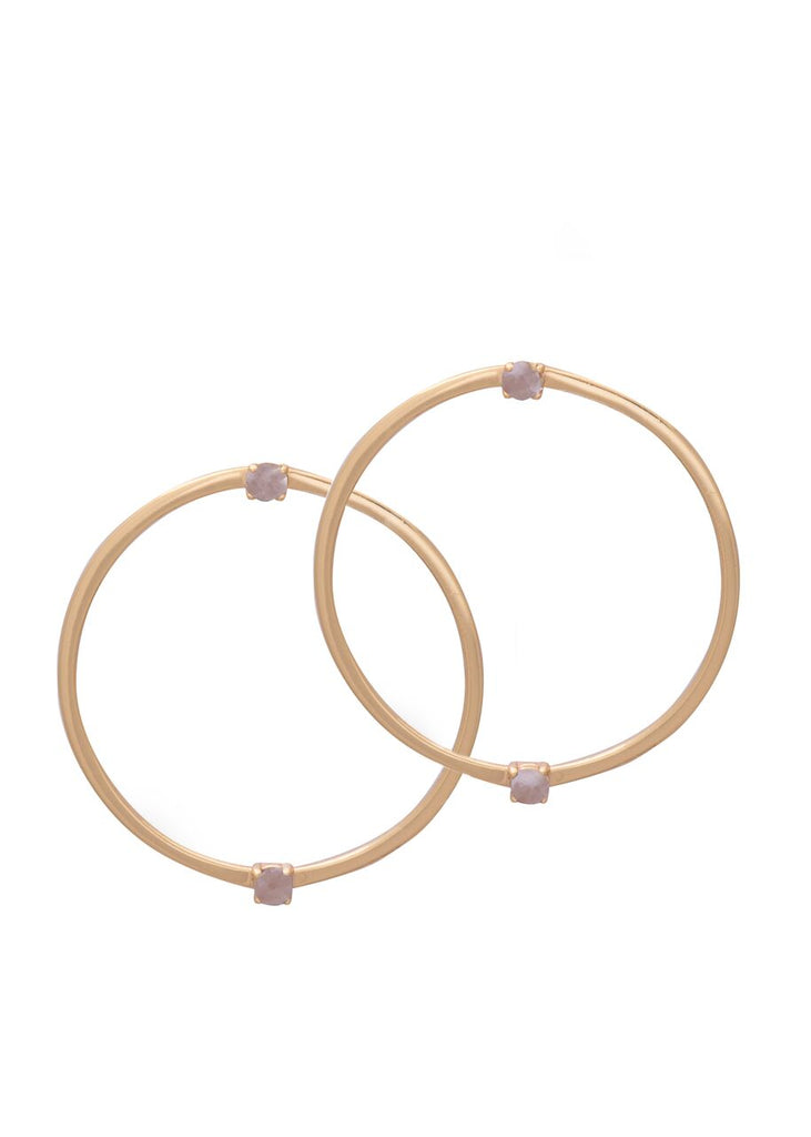 Image shows a pair of front facing hoops by Sarah mulder. The pulse earrings are gold and have small semi precious gemstones at the stud of the earring and parallel at the bottom of the hoop.