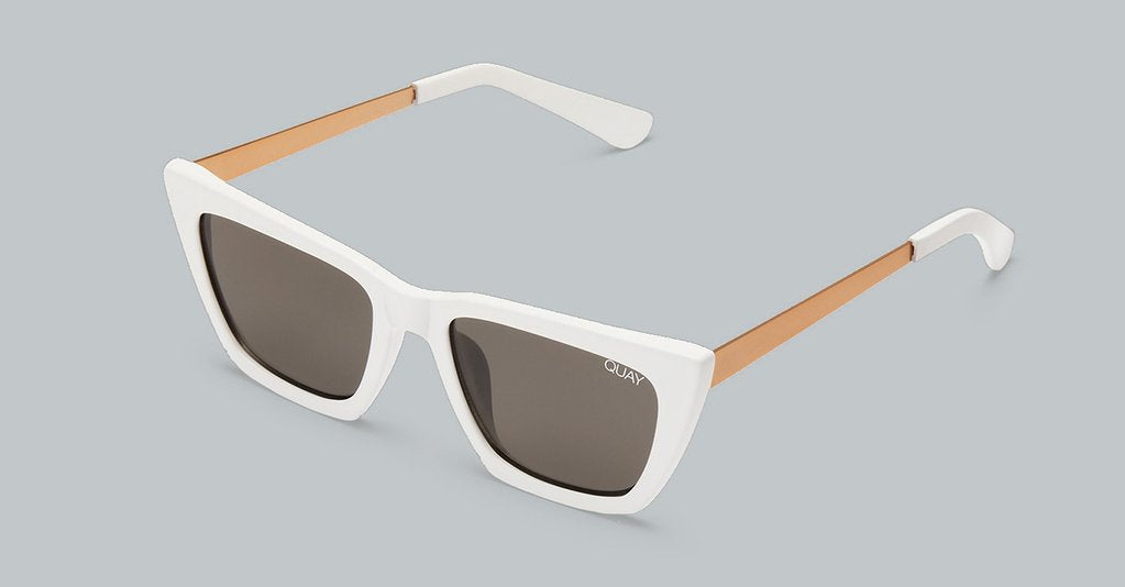 The Don't @ me sunglasses from Quay Australia are White framed sunglasses with golden metal arms and smoke shade lenses.
