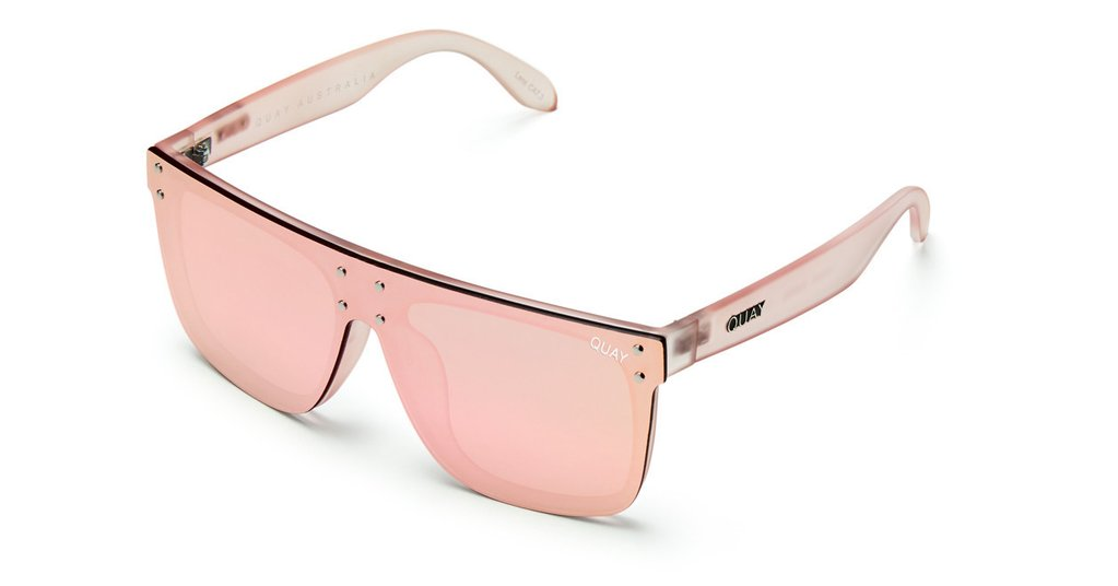 Image shows a Large frame Quay Australia sunglass. The Hidden hills sunnies comes with a grey reflective lens and pink arms.