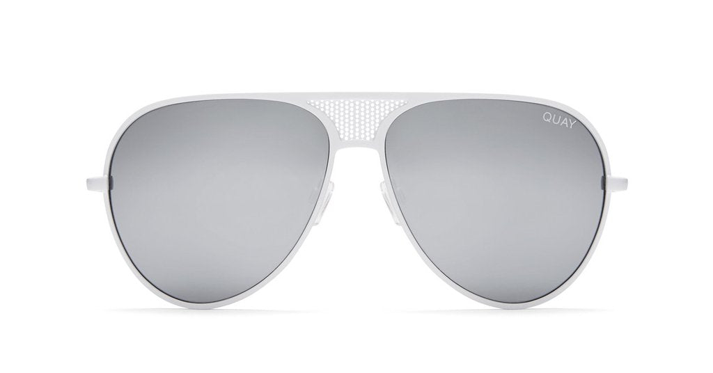 Image shows a pair of White framed aviator style Quay sunglasses. The Iconic sunnies comes with silver reflective, gradation lens.
