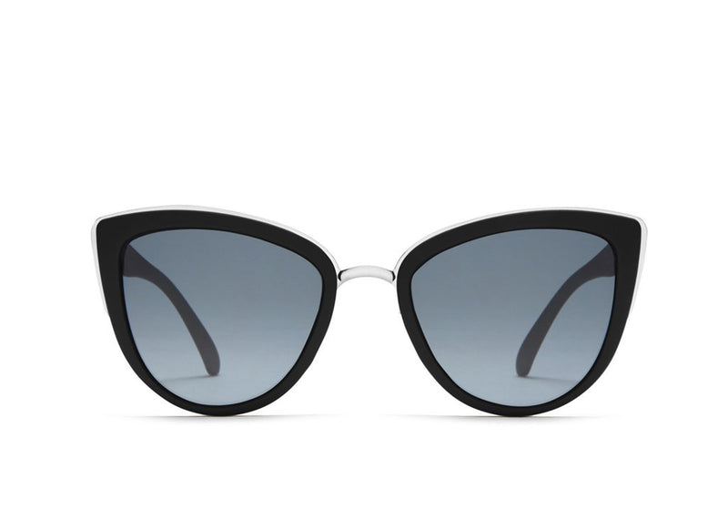 UNIKONCEPT:Lifestyle boutique; image shows a pair of Quay sunglasses. The my girl sunglasses are a large black framed glass, like a circular cat eye and feature small gold details around the tails of the sunglass.