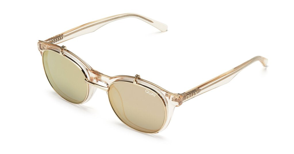 Image shows a Champagne coloured transparent framed Quay sunglass. The penny royal sunglass comes with a flip up shade lens and clear lens underneath.
