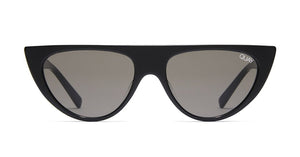 Image shows a Black narrow cat eye Quay sunglass. The run away sunglass comes with smoke lens and a straight across top.