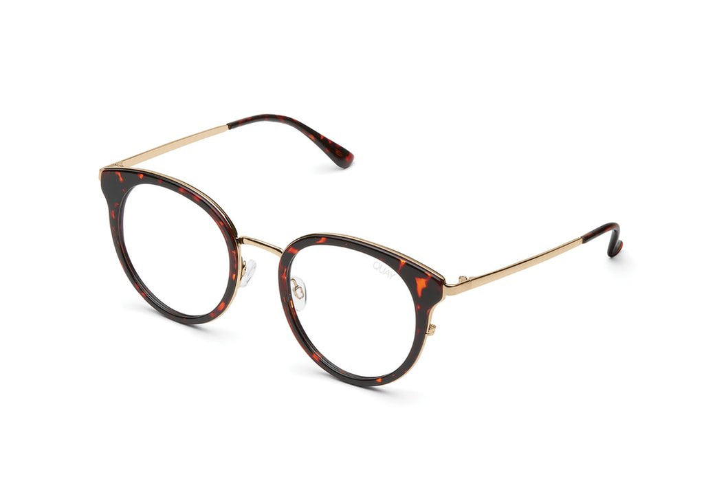 The Cryptic blue light lens glasses from Quay Australia are framed in tortoise shell with a gold nose bridge.