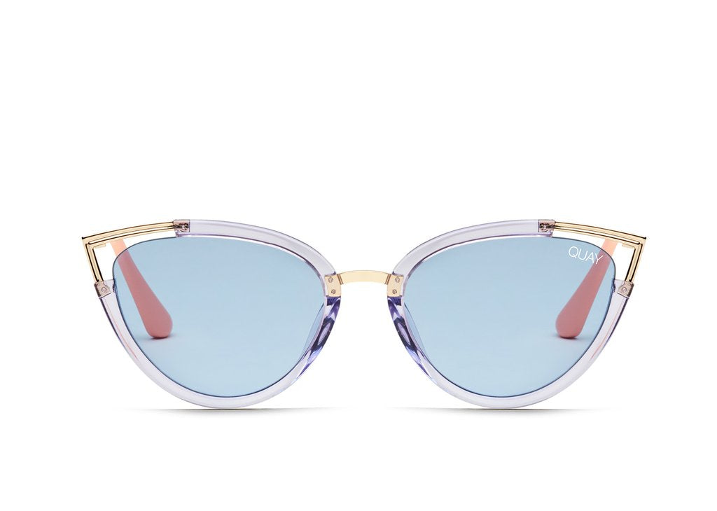Purple framed, cat eye sunglasses with gold peaks on the edge of the cat eye and pink arms.