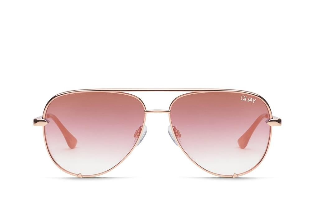UNIKONCEPT: Lifestyle boutique; image shows a pair of quay sunglasses. The high key rimless in copper rose are an aviator styled frame with rose gold/copper frames, lenses and arms.