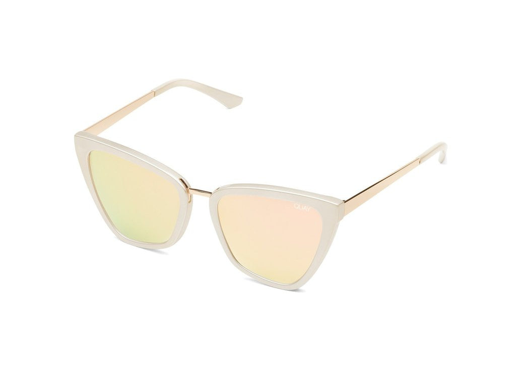 UNIKONCEPT: Lifestyle boutique; image shows a pair of quay sunglasses. The Reina sunglasses are a cat eye styled sunglass with an opal frame and a metallic rose gold lens.