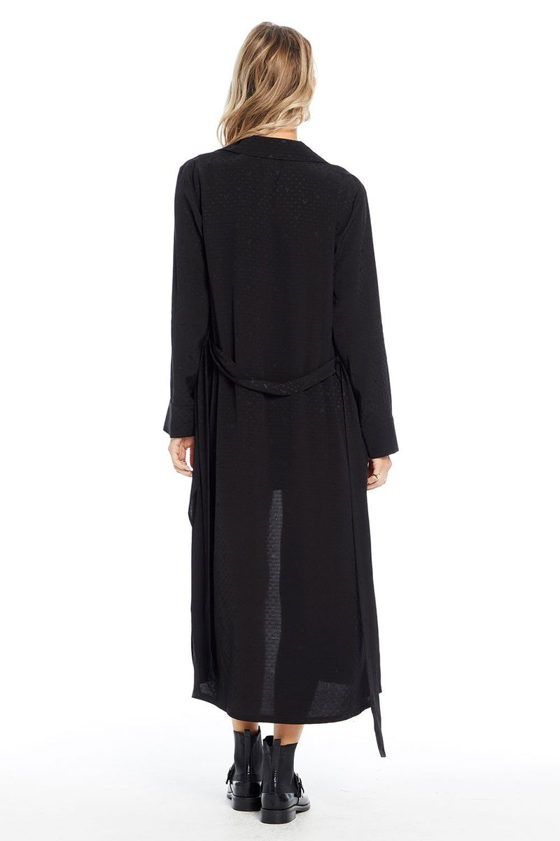 UNIKONCEPT: Lifestyle boutique; Image shows a long, open, black duster by Saltwater luxe. This duster is ankle- floor length, features a wrap around belt that can be tied In the front or behind and has subtle starred detailing throughout with a beautiful silky sheen to the fabric.