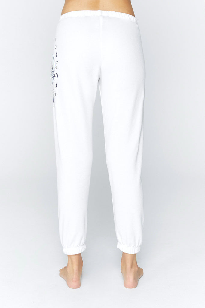 UNIKONCEPT Lifestyle boutique: image shows the Seeing Eye to Eye sweat pants by Spiritual Gangster. These white sweats taper perfectly to provide a slim fitting leg with an elasticized waist band and ankle cuffs. The left hit features a small seeing eye mural.
