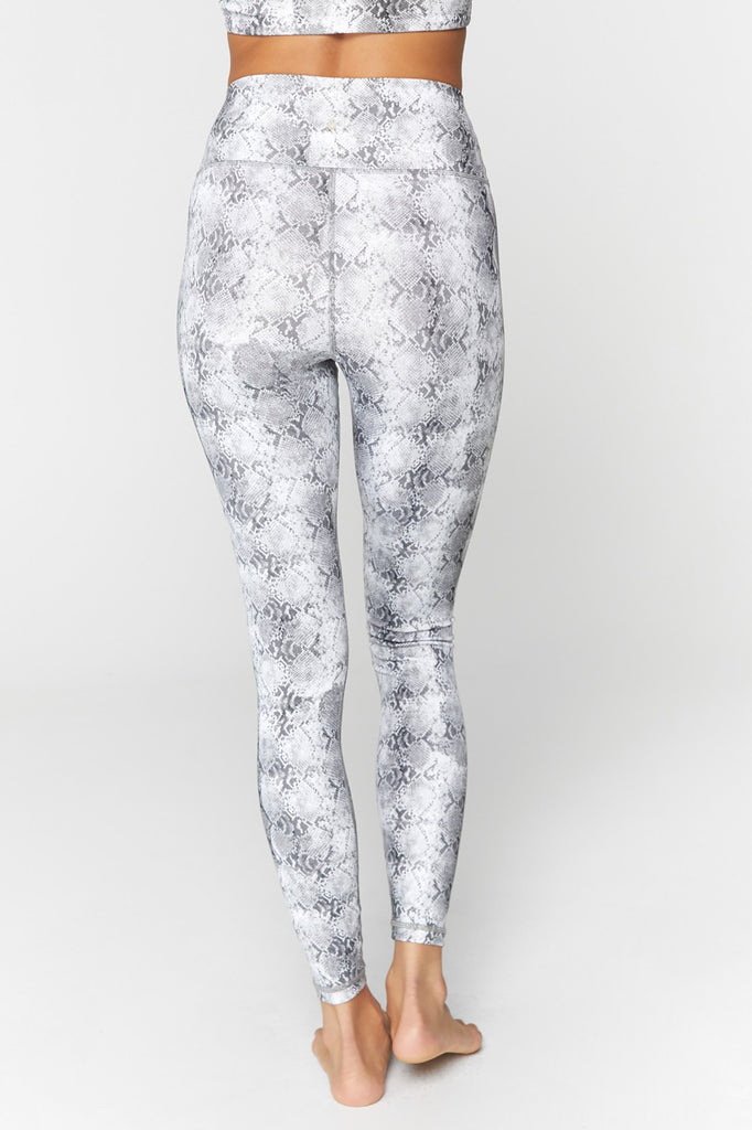 UNIKONCEPT Lifestyle boutique: Image shows the essential HW leggings by Spiritual Gangster. These ultra flattering highwaisted leggings come in a grey snake print.
