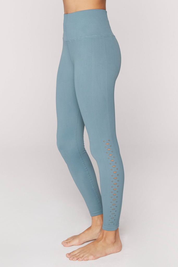 UNIKONCEPT Lifestyle boutique; image shows the Self Love Leggings in Nomad by Spiritual Gangster. These high rise full length leggings feature small cut out details down the side of the legs.