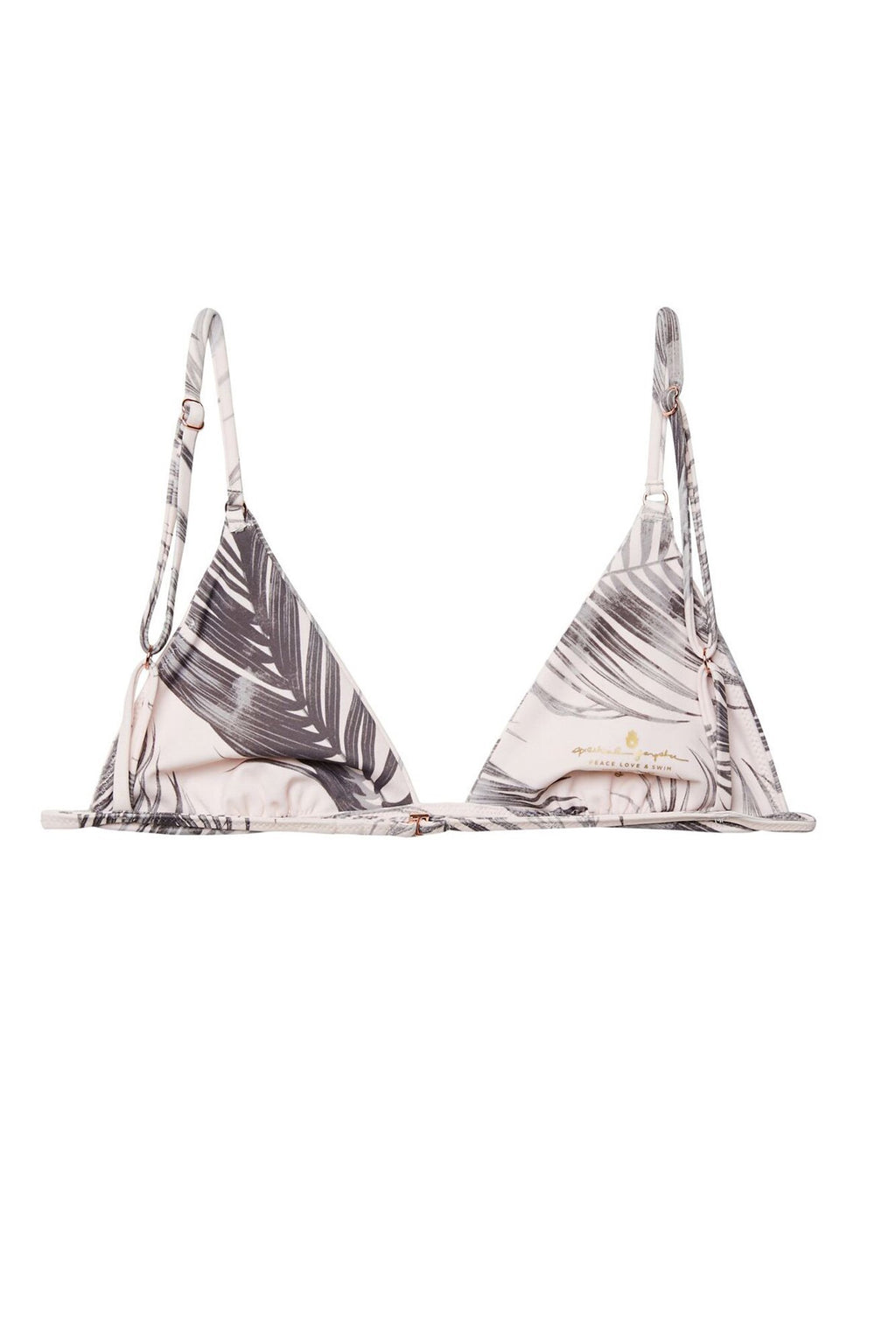 UNIKONCEPT Lifestyle boutique: Image shows a model wearing a spiritual gangster bikini top. The breezy bikini top it comes with a pink base and grey palm leaves, the top features a triangle top with spaghetti straps