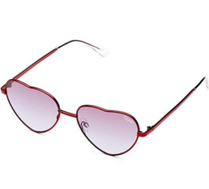 UNIKONCEPT Lifestyle boutique; image shows the Kim sunglasses by Quay and Elle Ferguson. These soft heart shaped sunglasses feature a red frame and purple lenses.