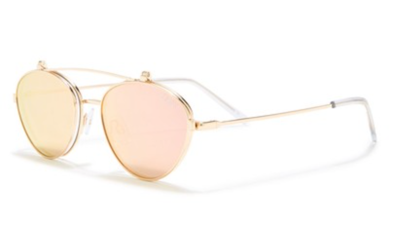 UNIKONCEPT Lifestyle boutique; image shows the Elle sunglasses in gold and rose by Quay and Elle Ferguson. These classic sunnies provide you with the option to protect your eyes from the sun, or flip the lens up to show off your eyes. These glasses have a rounded, thin frame.