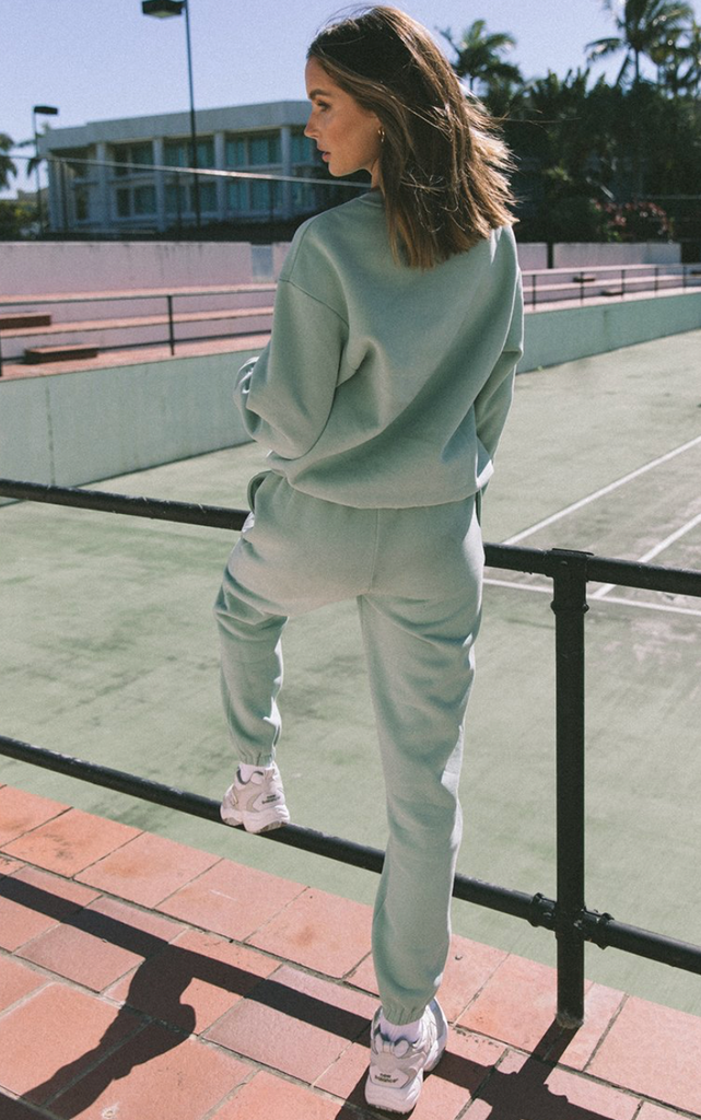 UNIKONCEPT Lifestyle boutique; image shows the mint green Seafoam Track Pants by Runaway. These high waisted tailored sweats feature an elasticized drawstring waist band, and elasticized ankle hems.