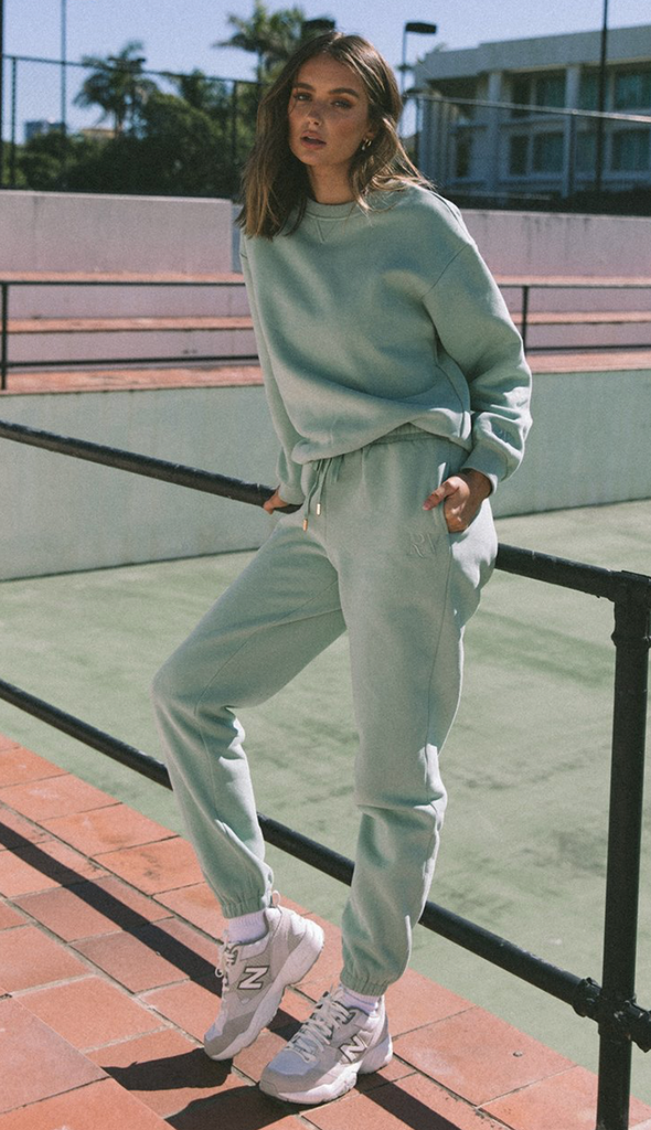 UNIKONCEPT Lifestyle boutique; image shows the mint green Seafoam Jumper by Runaway. This classic crewneck sweater features a fitted bottom hem.