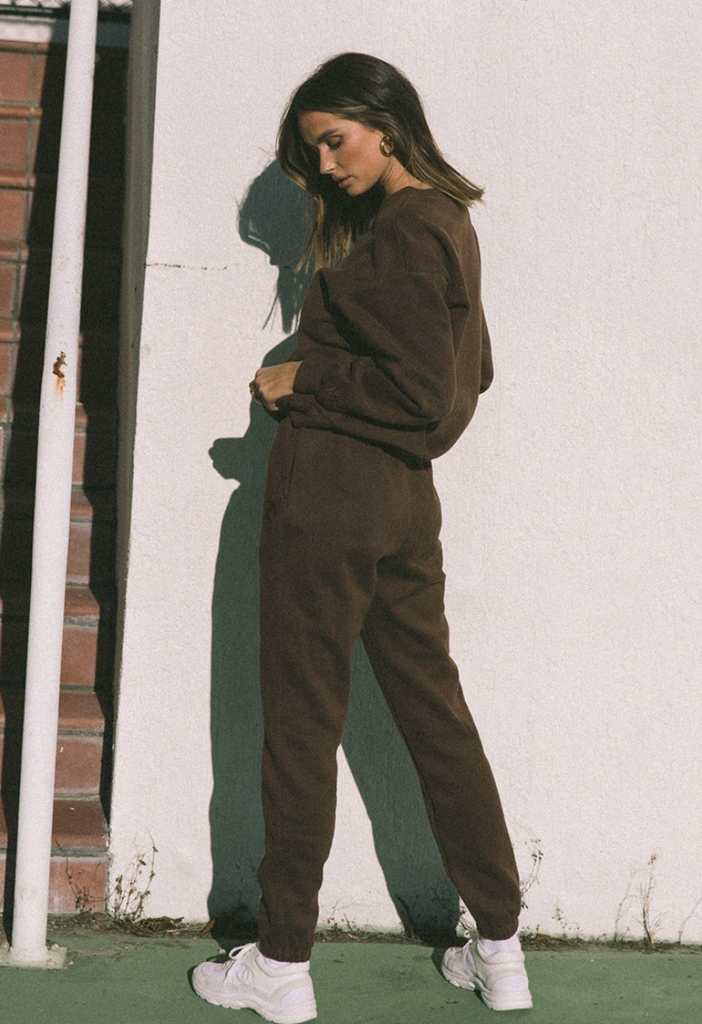 UNIKONCEPT Lifestyle boutique; image shows the Chocolate Track Pants by Runaway. These high waisted tailored sweats feature an elasticized drawstring waist band, and elasticized ankle hems.