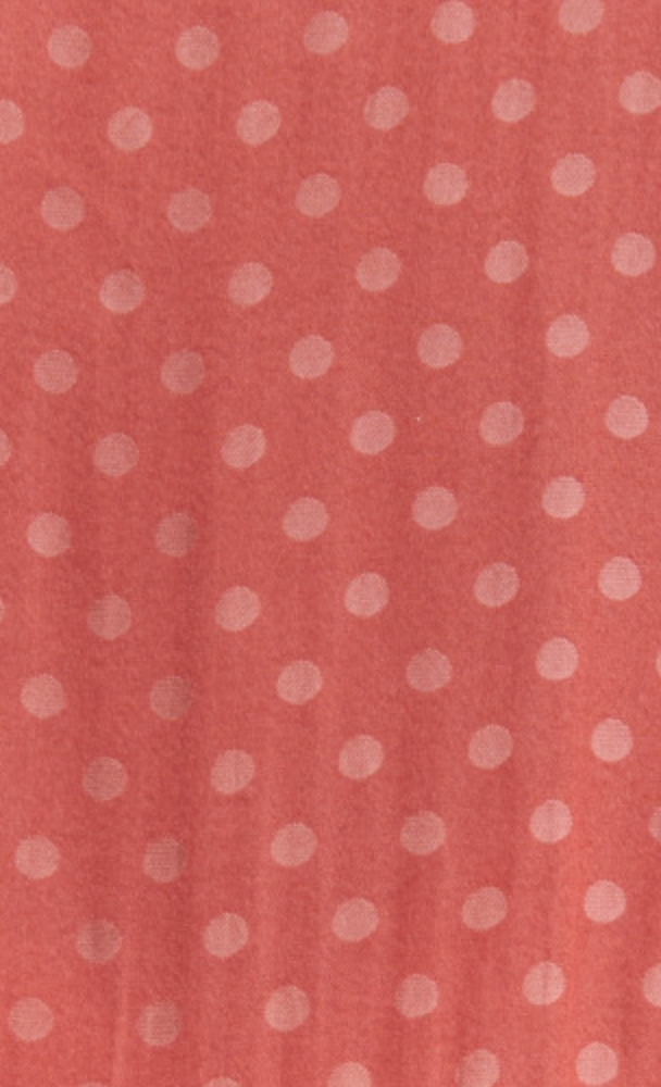 Close-up of fabric details. Silky fabric with sangria colour base, and lighter dots.