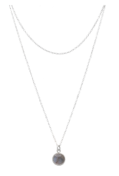 Image shows a silver necklace by Sarah Mulder. The Faye necklace is a layered necklace with a short silver chain and a long chain with a circular semi precious gemstone.