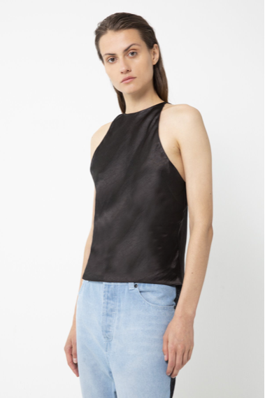 UNIKONCEPT lifestyle boutique: Model is wearing black, silk-like, high-neck third form camisole. The bias high neck cami features spaghetti straps and a key hole back that ties.
