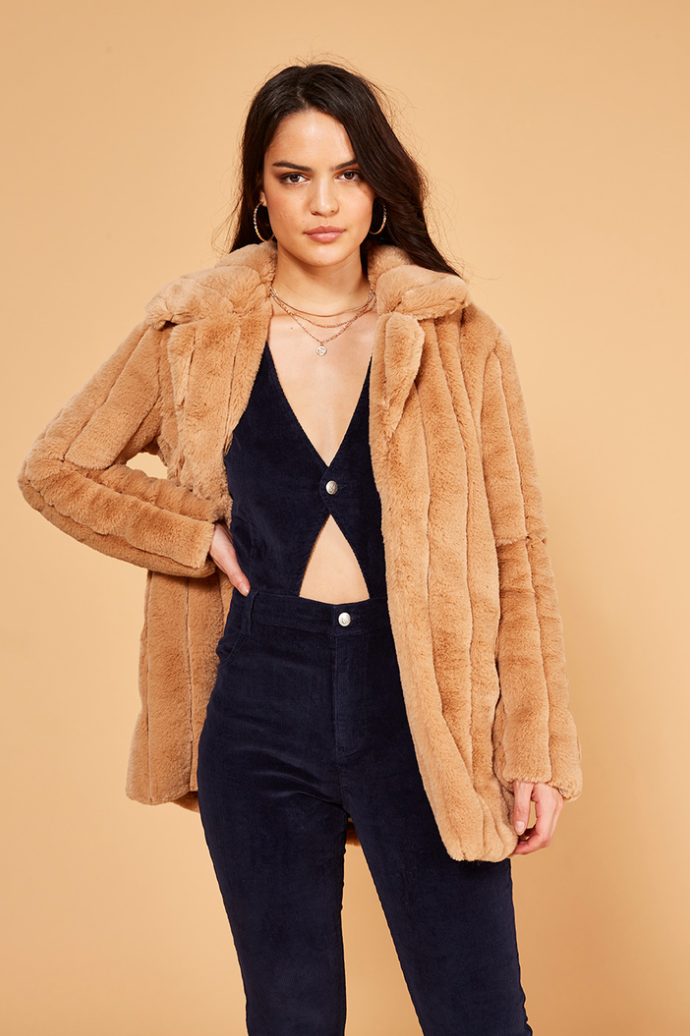 UNIKONCEPT: Lifestyle boutique; image shows an resized faux fur coat by Minkpink. The Kimbra coat is a long sleeved faux fur coat in a teddy taupe colour. It features a large collar around the neckline and hook and eye closures.