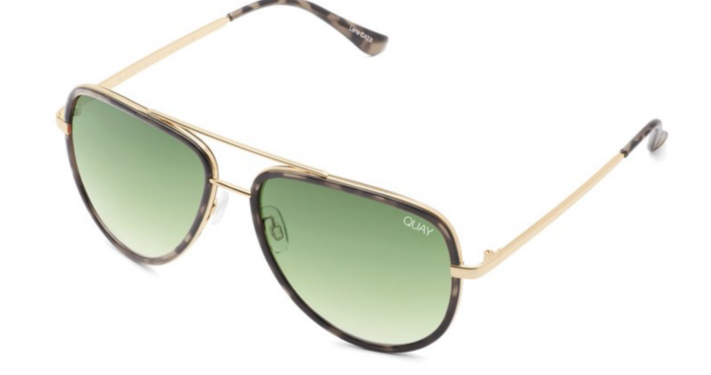 UNIKONCEPT: Lifestyle boutique; Image shows an aviator styled sunglass by Quay. The All in sunglass by Quay is in the colour milkycamo and green fade. It has a gold bridge over top on the nose.