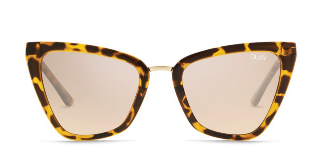 UNIKONCEPT: Lifestyle boutique; Image shows a pair of cat eyed sunglasses by Quay. The Reina sunnies feature a tortoise shell frame and a light brown coloured lens. It also features gold detailing.