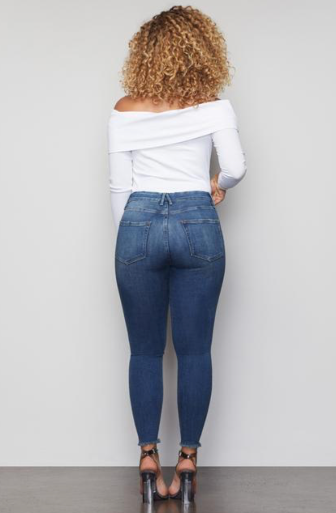 UNIKONCEPT Lifestyle boutique: Image shows the Good Leg Fray Hem In Blue by Good American. This high waisted skinny jeans come in an acid wash mid blue, and feature a distressed, frayed hem at the ankles.