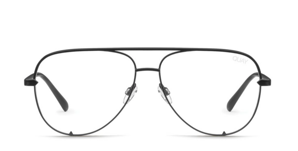UNIKONCEPT: Lifestyle boutique; Image shows a pair of Quay Australia glasses. The high key blue light lens has transparent lenses with a blue light feature to them to eliminate the strain of light radiating from electronic devices. This pair comes in an aviator style with black and gold frames.