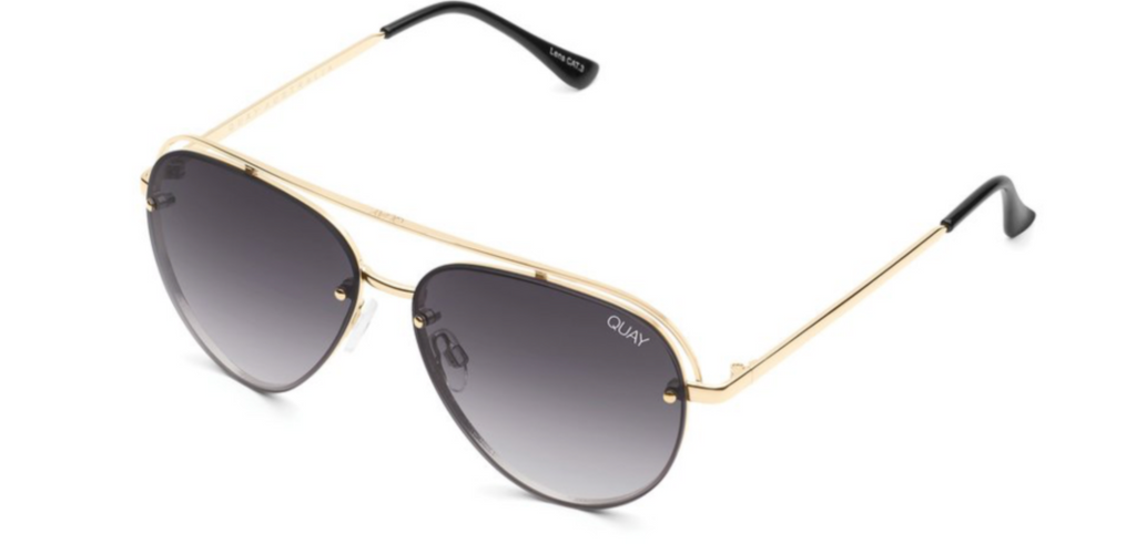 UNIKONCEPT: Lifestyle boutique; Image shows a pair of aviator styled sunglass. The long story sunglass has a dark grey/smoke coloured frame with gold metal detailing around the glass and for the arms. It also features a straight bar across the eyebrow.