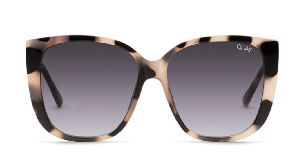 UNIKONCEPT: Lifestyle boutique; Image shows a large framed pair of quay sunglasses. The ever after sunnies features a large, oversized rounded square frame with a milky tortoise shell print and a grey glass. The full frame is plastic.