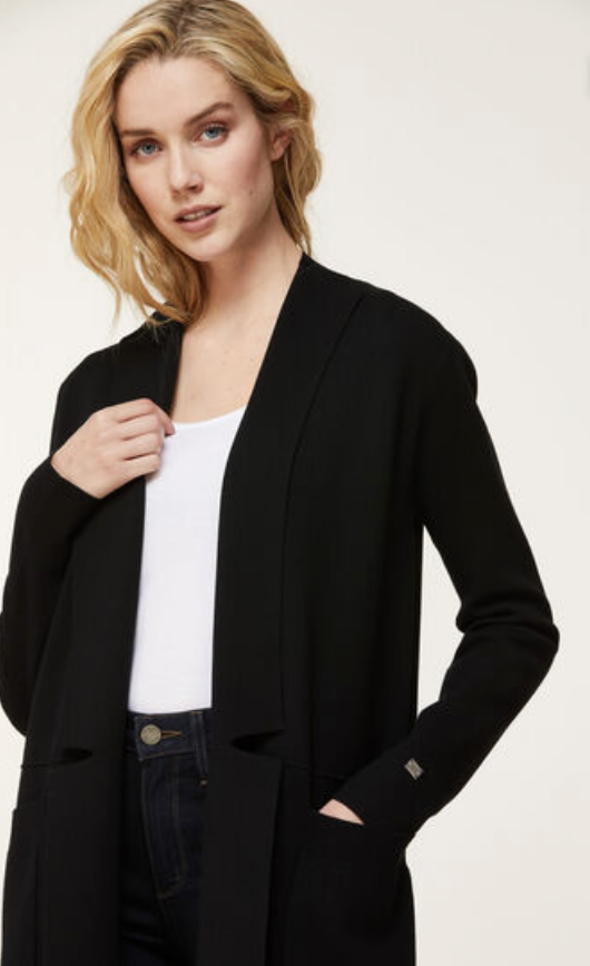 UNIKONCEPT: Lifestyle boutique; image shows a black knitted cardigan by soia and Kyo. The Benela in black features two square front pockets. It is a completely open cardigan with two small flaps on either side. Mid length with long sleeves